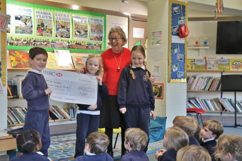Cheque presentation to Save the Children