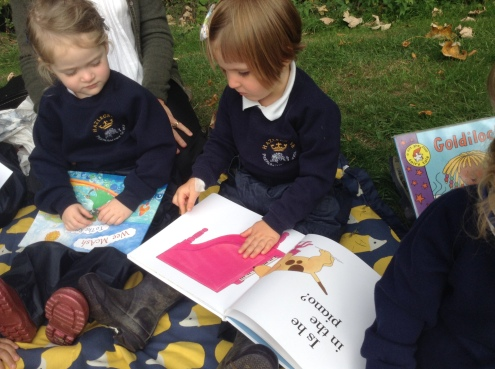 Nursery reading their books in the woods